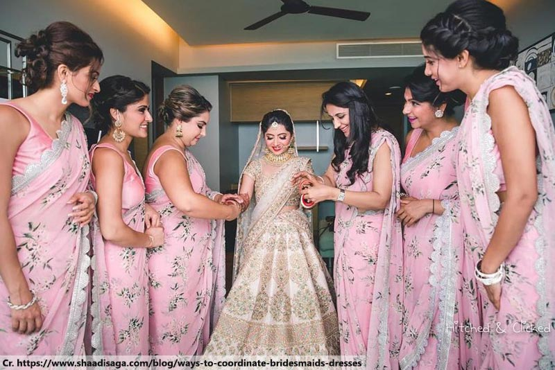 Colour-coordinated bridesmaids Indian Wedding